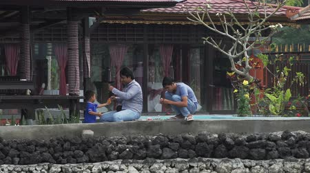 BALI INDONESIA, OCTOBER 2017: Father teaching his son to fish on Lake Batur