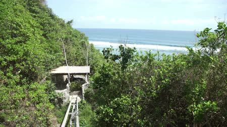 crevice : Cliff lift to Sundays beach Club from Ungasan Clifftop Resort at Bali, Indonesia Stock Footage