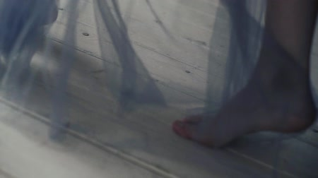 Beautiful young girl bare feet moving on interior in the living room in slow motion.
