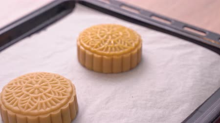 brushing : Process of making moon cake for Mid-Autumn Festival - Woman brushing egg liquid on pastry surface before baking. Festive homemade concept, close up. Stock Footage