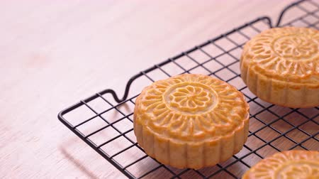 Fresh baked Chinese moon cake pastry for traditional Mid-Autumn festival, close up, truck shot movement. 4K Resolution.