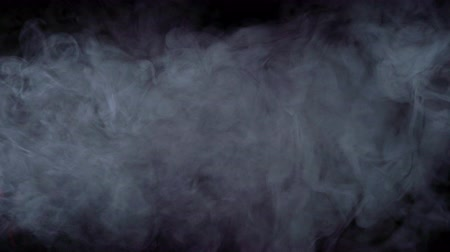 elszigetelt fekete : Realistic smoke, fog, haze isolated on black background, screen mode for blending overlay effect. Slow motion 4K shot. Atmospheric mood VFX. Stock mozgókép
