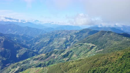 Drone flying toward through the beautiful Mt.Hehuan, Hehuanshan, in Taiwan Central Mountain range, with flowing cloud sea and blue sky, aerial view. Wideo