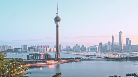 ミッドタウン : Panorama panning view of Macau (Macao) city skyline during sunset dusk time with Macau tower landmark and Ponte de Sai Van Bridge, concept of busy city.