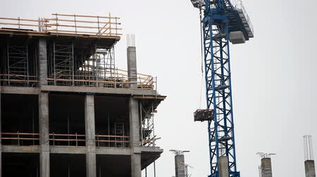 site : Construction site with working blue crane Stock Footage