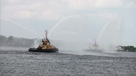 to celebrate : Fireboats casting water streams in celebration during Riga marathon