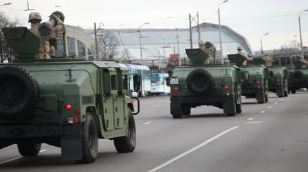 riga : Riga, Latvia - November 18, 2013: The Latvian National Armed Forces trucks participate in the Independence day military Parade. Since 29 March 2004 Latvia is member of The North Atlantic Treaty Organization (NATO).