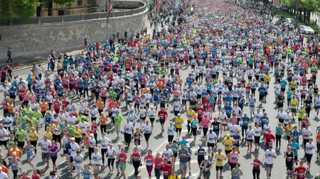 riga : RIGA, LATVIA - MAY 18, 2014: City Marathon mass start of 10 km distance at the Riga International Marathon. It is an annual road marathon and was established in 1991. It is internationally recognized with IAAF Bronze Label status.