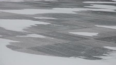 hóvihar : Snow blowing and drifting across a ice and snow covered stone tiles