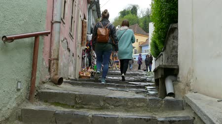 romeno : Sighisoara, Romania, May 3, 2016: People near Souvenir Shop in Sighisoara old town.