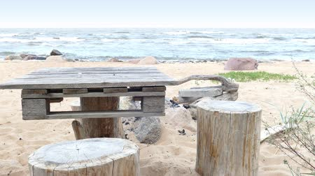 improvised : Empty Improvised Wooden Picnic Table on Sandy Beach