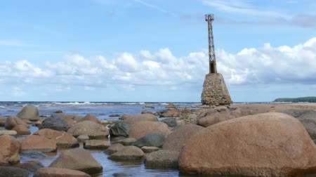 zkorodované : Rocky seashore with Ruins of the abandoned and sea-swept Kurmrags Lighthouse