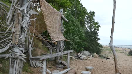 improvised : Improvised driftwood Beach shelter hut at sandy seaside