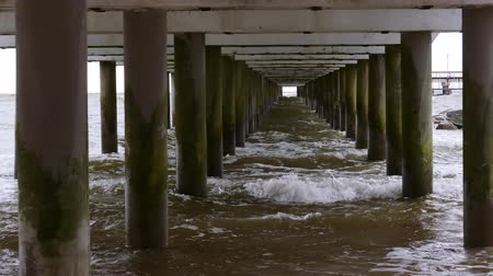 Under Pedestrian Sea Pier in Palanga during storm time