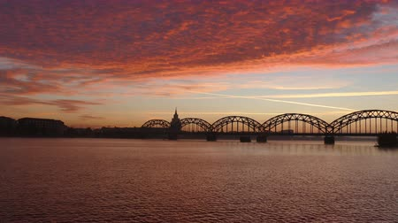 ラトビア : Riga Iron Railway bridge over River Daugava at sunrise