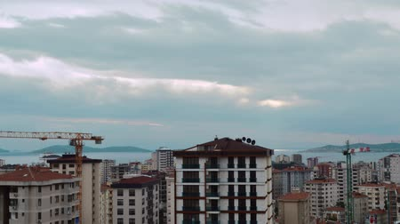 Timelapse of high angle view cityscape with running gray clouds in Kadikoy, Istanbul, Turkey. Construction with cranes concept. Stok Video