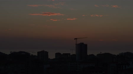 construction crane : Timelapse of high angle view cityscape at sunset in Kadikoy, Istanbul, Turkey