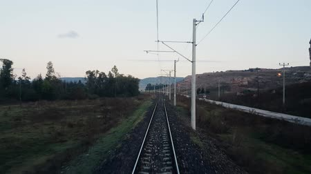 arriving : Travelling by passenger train in the morning, view from the rear of train