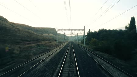 Travelling by passenger train in the morning, view from the rear of train