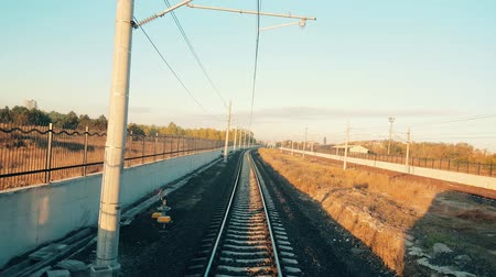 Train approaching to the station in Eskisehir in a beautiful sunny morning, view from the rear of train Stok Video