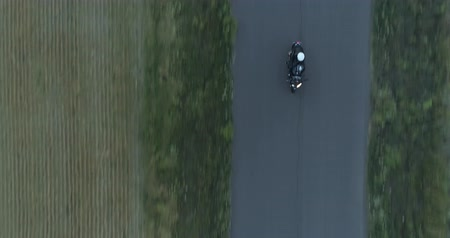ад : aerial shot of three motorcycles