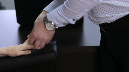 лояльность : Lie-detector test, a woman answers the questions of the expert A woman answers the questions of the expert polygraph sitting on a chair in an office