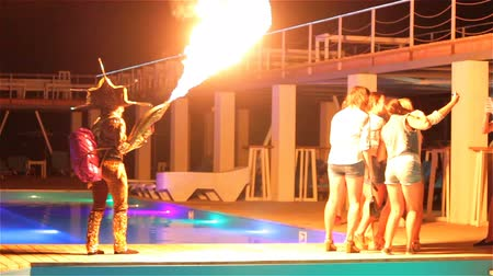 урод : Genichesk, Ukraine - August 30, 2017: Fire show on night pool party