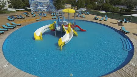 Genichesk, Ukraine - August 30, 2017: Aquapark with slides for family and children. Hotel pool. Wide angle.