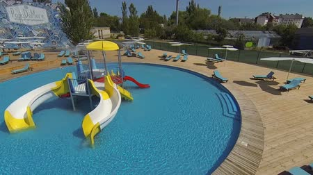 Genichesk, Ukraine - August 30, 2017: Aquapark with slides for family and children. Hotel pool. Panorama view.