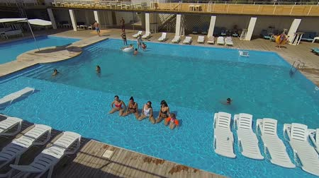 Genichesk, Ukraine - August 30, 2017: Hotel pool party. Girls have a photoshoot with mobile phone