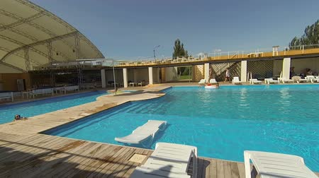 Genichesk, Ukraine - August 30, 2017: Hotel pool. PapaDeMore club and resort. Panorama wide angle view.