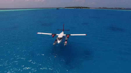 pervane : Seaplane on background water surface and horizon in Maldives. taking off