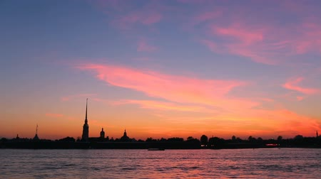 chapel : silhouette of Peter and Paul fortress against the backdrop of the setting sun