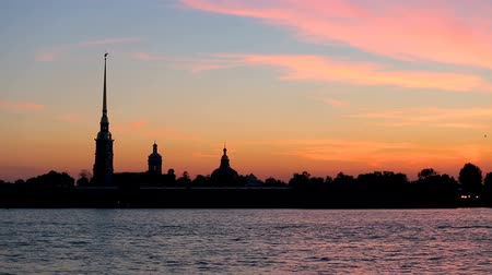bastião : silhouette of Peter and Paul fortress against the backdrop of the setting sun