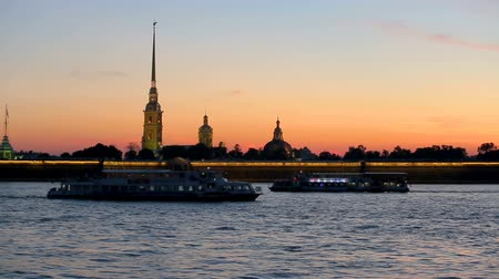 moorage : Illumination of Peter and Paul fortress against the backdrop of the setting sun