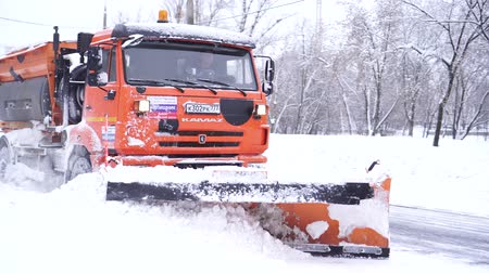 swabber : special vehicle cleans the carriageway during a snowfall in Moscow Stock Footage