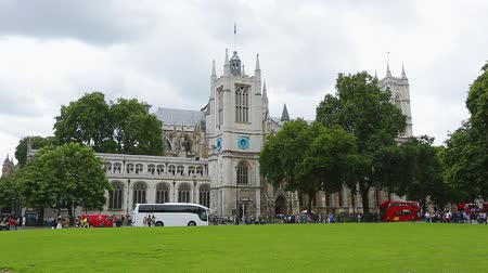 london cab : View of Parliament Square Garden and Westminster abbey, cloudy day in summer