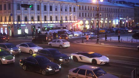 nevsky : Top view of crossroads. Nevsky prospect and Griboedov chanel emb. Winter evening Stock Footage