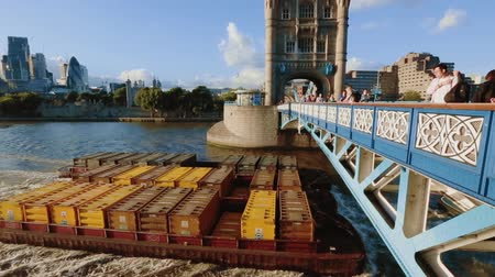 cargo barge passes under the Tower Bridge, Thames river Стоковые видеозаписи