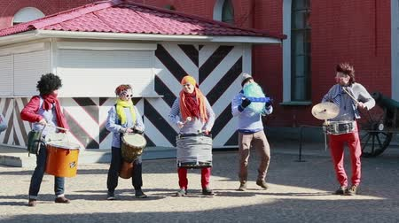 clowns play music at Funny festival XVI in Saint-Petersburg