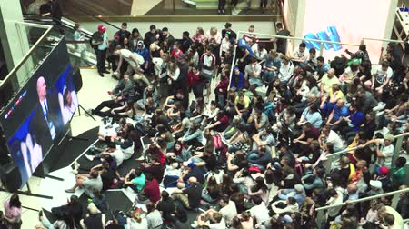 fans watch the live broadcast of the Russia-Uruguay match in the mall Gallery