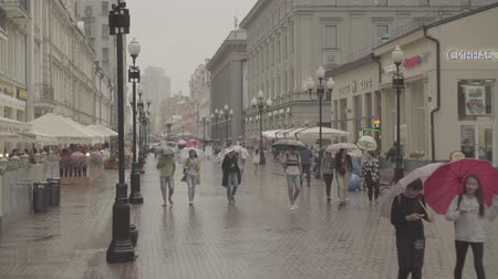 chant : People walks on Old Arbat street during rainy summer day. Moscow downtown