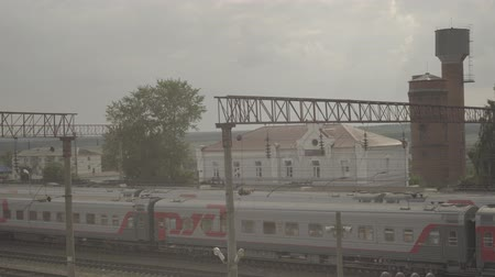 long-distance train on small station Uzunovo. RZD company Stok Video
