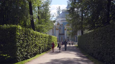 Walking to Pavilion Hermitage on artificial island in Alexandrovsky Park
