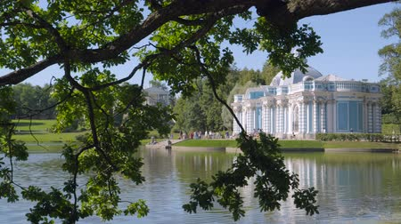 Walking to Pavilion Hermitage in Alexandrovsky Park in summer sunny day