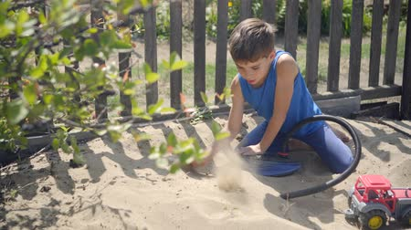 using a pump, a curious child modeled a volcano eruption in a sandbox