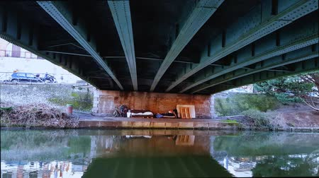 pieski : A sleeping place with a homeless person under a bridge in the center city. Toulouse.