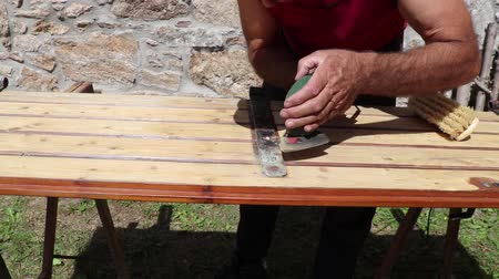 sand paper : Cleaning an old wooden door. Polishing with sander.