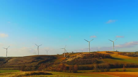 sustainable resources : Wind turbines twist blades in the wind Stock Footage