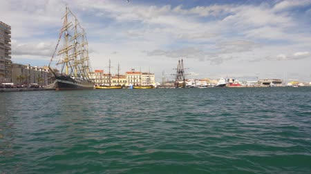 lanoví : View of the lagoon with ships in the modern city .